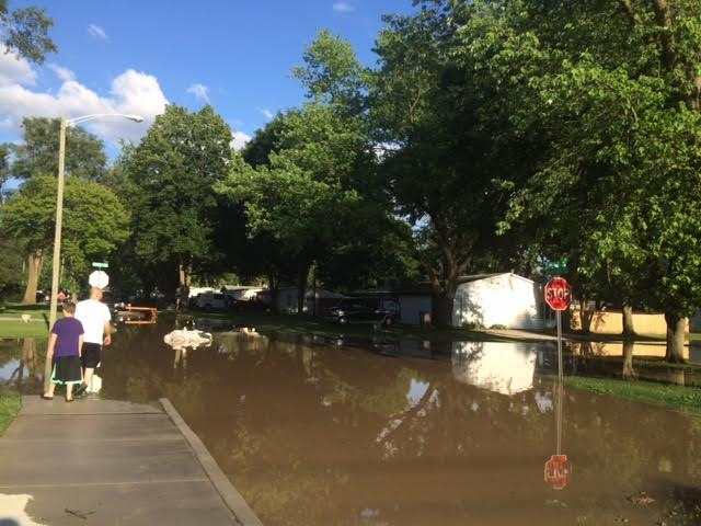 Residents observe rising flood levels in the Belle Vista neighborhood of Fort Wayne.