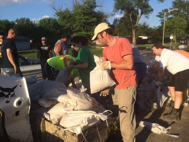 A crew comprised of City workers and volunteers fills sandbags to prevent flood damage in the Belle Vista neighborhood of Fort Wayne.
