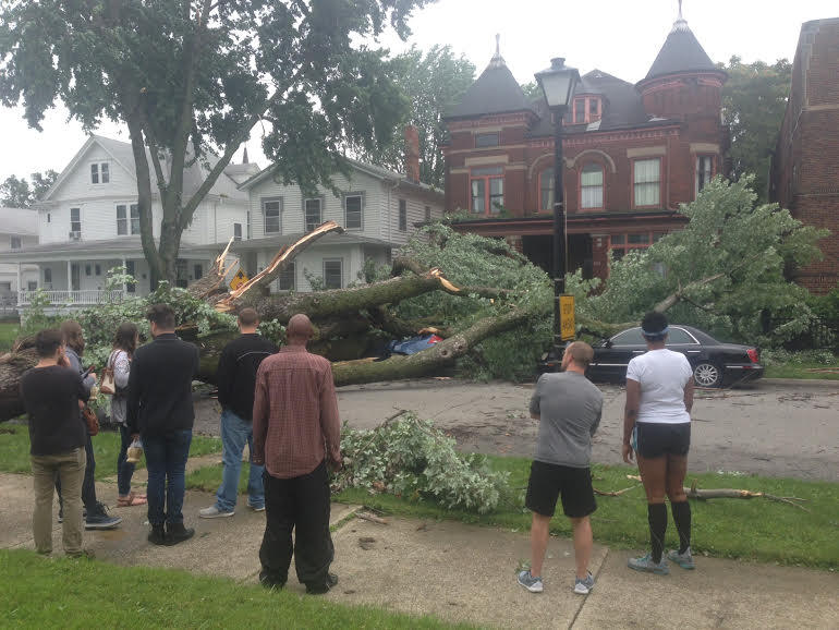 Residents of the West Central Neighborhood survey the damage on Wayne Street.
