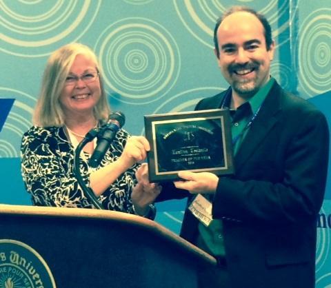 IPFW's Director of Keyboard Studies, Hamilton Tescarollo proudly accepting IMTA's 2015 Teacher of the Year award.