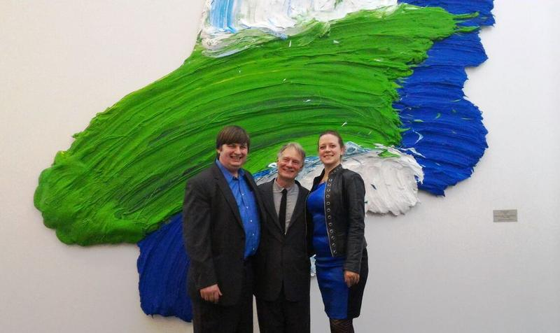 "Meyer (left), celebrating the completion of ""Artwork in Progress"" at the One World Trade Center, with artist Donald Martiny and Joslyn Elliott, Meyer's wife, and Associate Curator of Exhibitions, FWMoA"