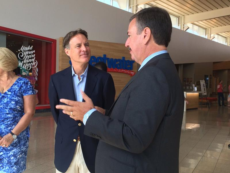 Forrmer Senator and Governor Evan Bayh talks to Sweetwater Sound owner Chuck Surack.