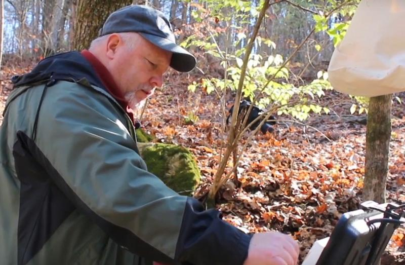 "Rick Wilson, on location, working on one of the 70 State Park paintings included in his traveling exhibit, ""The Nature of Art: Painted Parks."""
