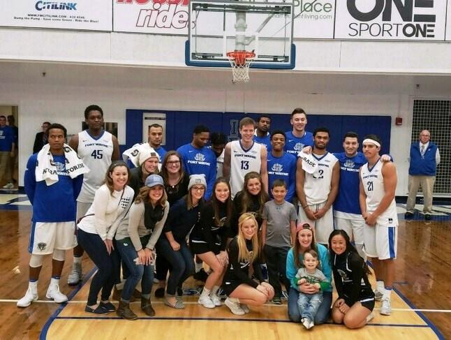 Ambassadors with their young hero, Jet, enjoying a day with IPFW's Mastadons.