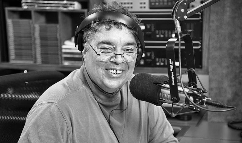 "David Calderon, host of WBOI's ""Connexxion Latina,"" behind the mic, getting ready to record his weekly assortment of Latin American music and news."