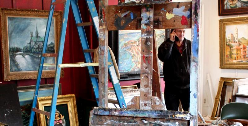 Artist, Tim Johnson, preparing for his holiday show in his B Building Gallery in West Central