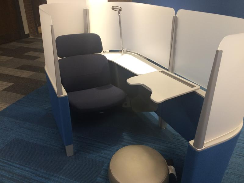 The study pods have a foot rest, reading lamp, desk and outlets.