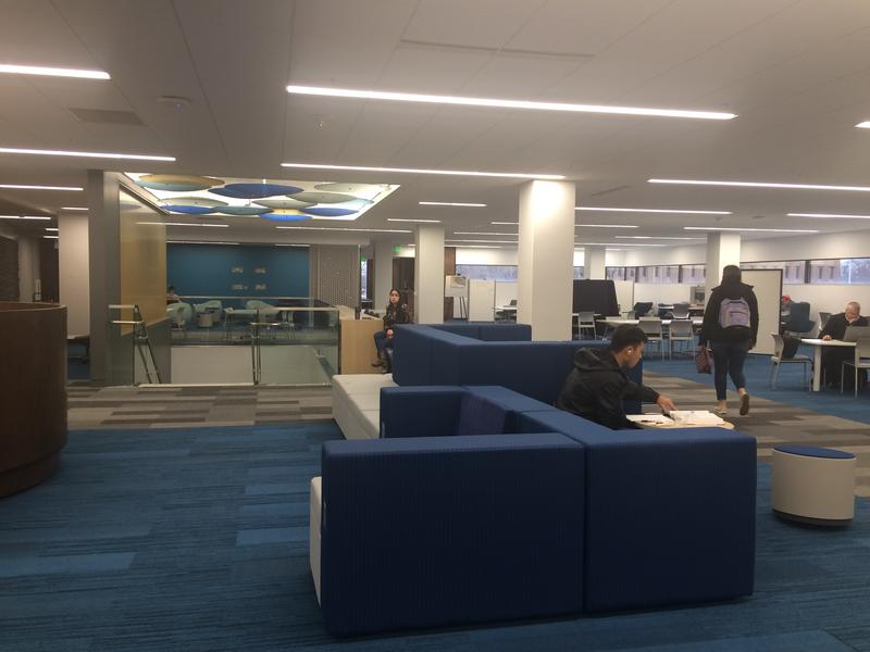 The second floor of Helmke Library includes group study rooms and a media wall, with a screen for students and faculty to give presentations.