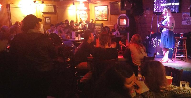 """Charlie Hester, one of this year's festival headliners, playing to a packed house last year at Fort Wayne's weekly """"Laughs at the Latch"""" night."""