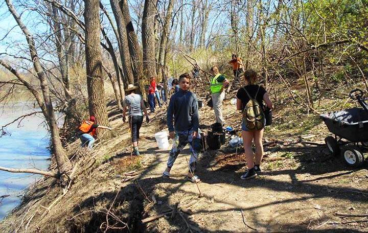Tree planting in progress along the banks of the  Maumee River, on a Save Maumee Grass Roots Organization work day.