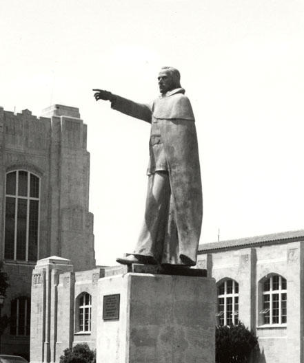"""The Jesuit Priest,"" sculpted by Hector Garcia in 1976, points to the confluence of the three rivers in downtown Fort Wayne"