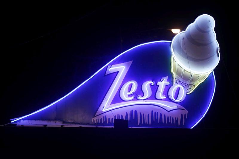 Night view of Broadway Zesto's familiar branding.