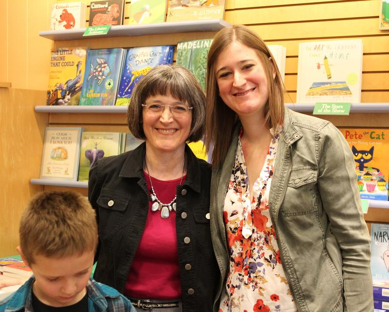 Holly at book signing with her daughter, one of the author's biggest fans.