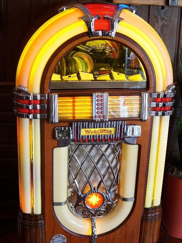 """A jukebox from """"back in the day"""" was added to the drive in's lobby a decade of two ago to toast the store's bygone era."""