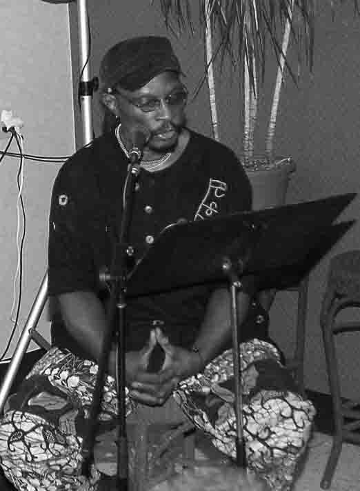 Ketu as poet, at a community spoken word gathering