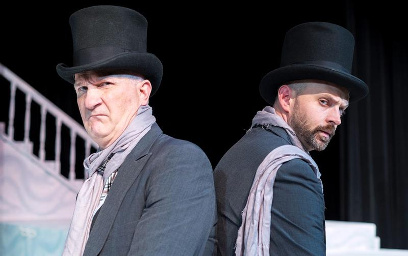 "Using multiple actors to play the part of Ebeneezer Scrooge, is one of Jack Cantey's many inventive devices employed in his new adaptation of ""A Christmas Carol"" at First Pres Theater. Pictured here are Scot McMeen and Billy Hofman."