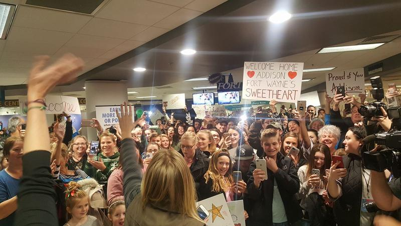 """Welcome Home"" crowd waiting to surprise Addison at the Fort Wayne International Airport"