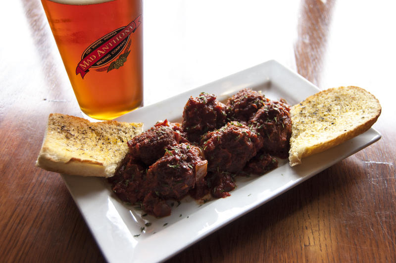 A serving of Jambalaya Meatballs symbolizes the Cajun flare & flavor of the original Mad Anthony menu.