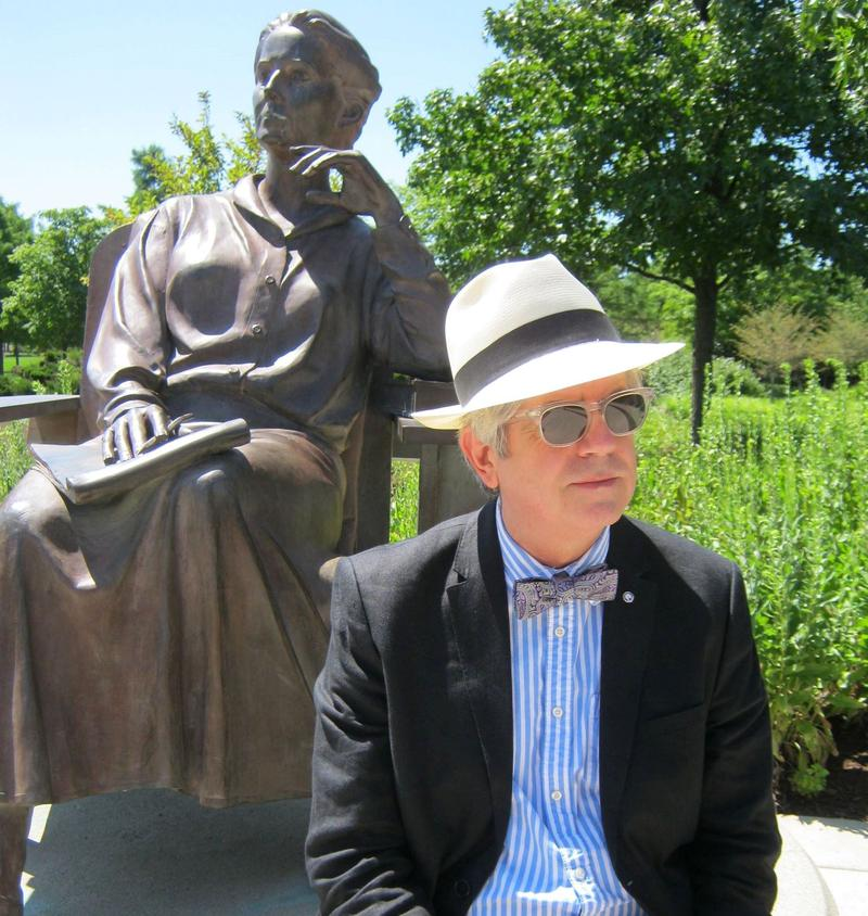 Martone beside a sculpture of his own muse, mythologist, Edith Hamilton, in Headwaters Park.