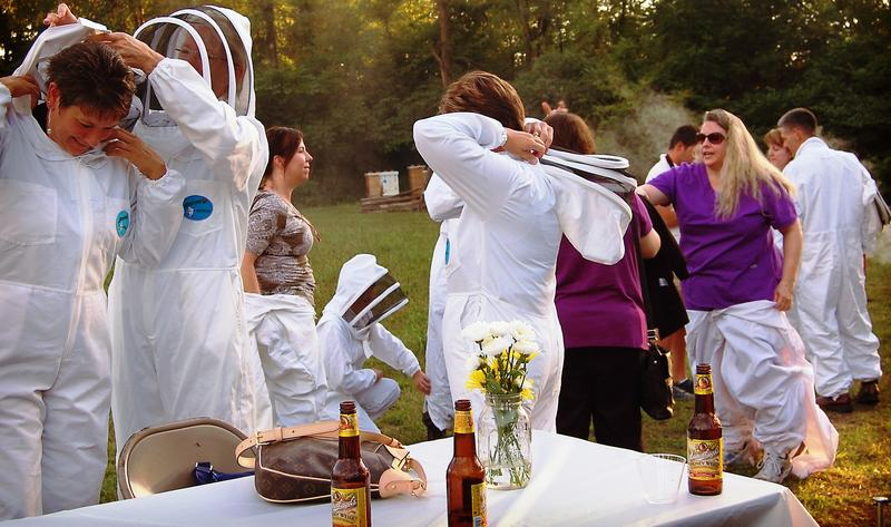 Suiting up for a live-hive beekeeping experience at last year's Bees & Brew event.