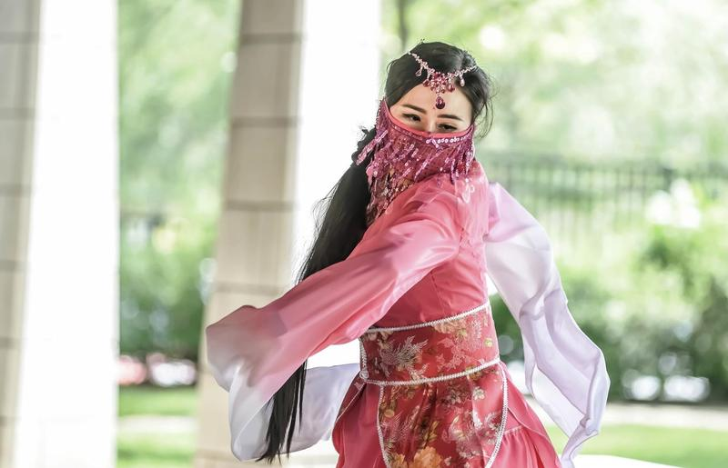 A Chinese dancer onstage at RiverDrums 2017, celebrating one aspect of the city's rich cultural heritage.
