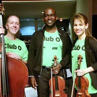 Brad Kuhns, Derek Reeves & Violetta Todorova pictured here with their own respective instruments, all teach violin to the Club O students.