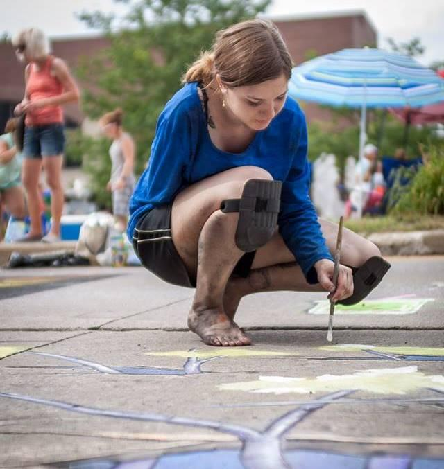 Lauren Castleman creates her piece at the Chalk Walk during the Three Rivers Festival