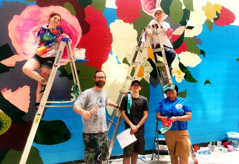 University of Saint Francis team working on Tim Parsley's 2018 installation in the Art This Way mural zone.