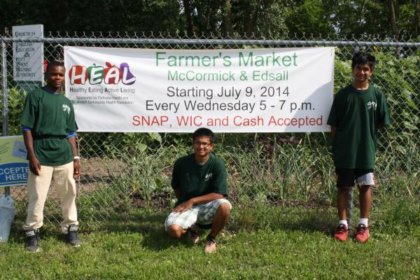 Young volunteers grow and sell fresh produce at the McCormick Farmer's Market in Fort Wayne.