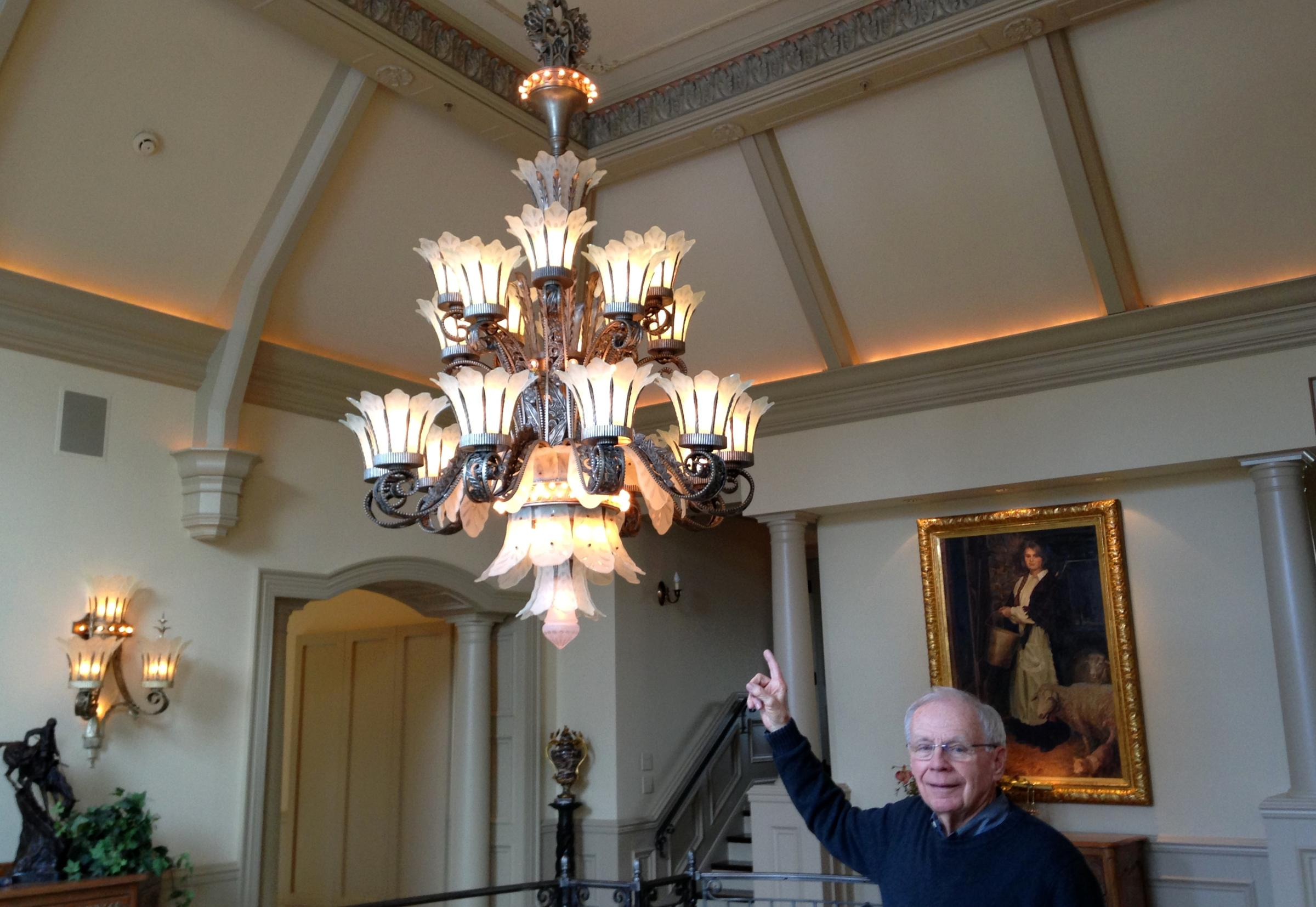 Citys past illuminated through historic lighting fixtures jim saxton with chandelier and one of its four matching sconces from the old paramount theatre in downtown fort wayne arubaitofo Image collections