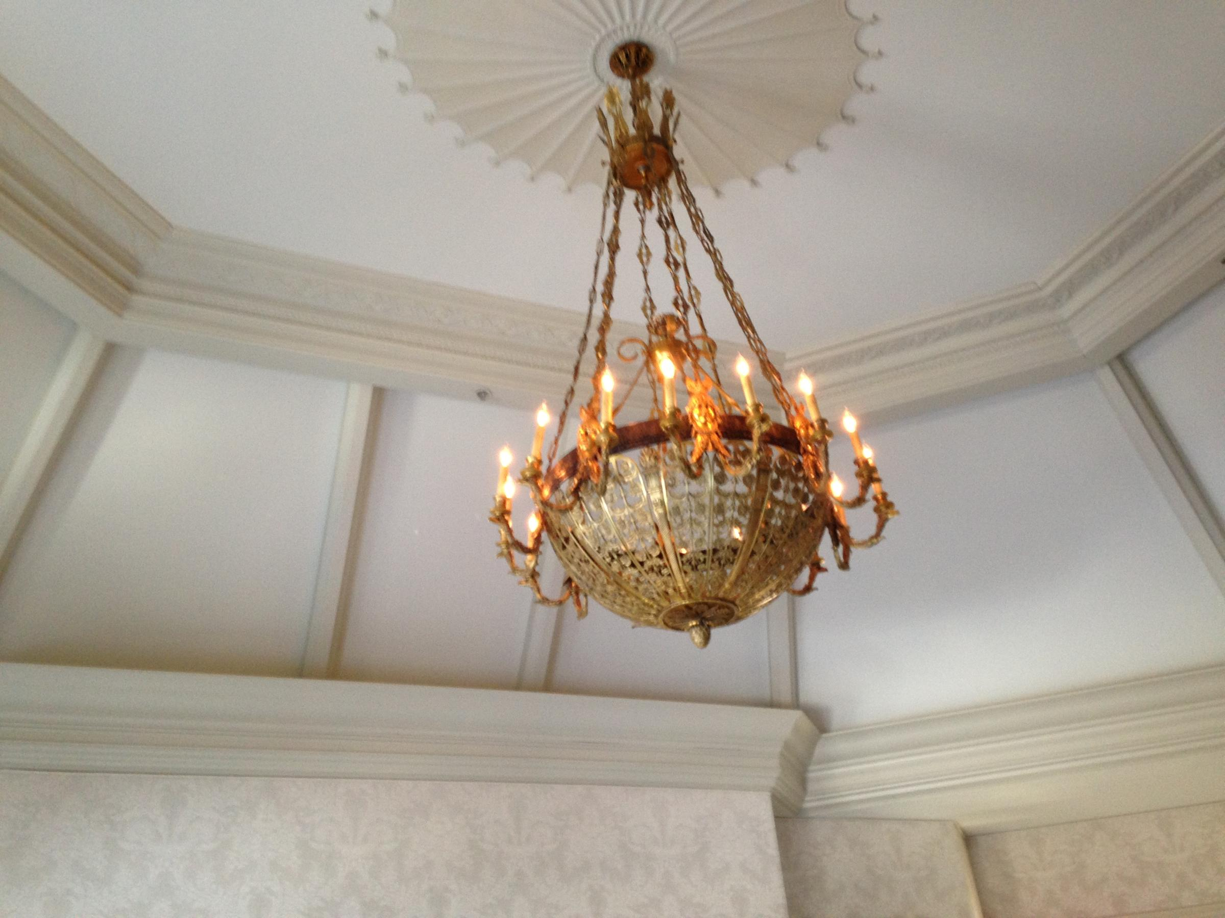 Citys past illuminated through historic lighting fixtures late mid 1800s french chandelier previously candle lighted restored to electricity in the early 1900s and re restored in 1995 now installed at a fort arubaitofo Image collections