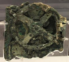 A fragment of the Antikythera Mechanism - an analog computer used to predict astronomical events. The mechanism dates back to the first century BCE and was found on the wreck of the Antikythera.