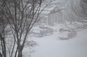 Snow plow makes its way down Water Street in Woods Hole early Friday morning.
