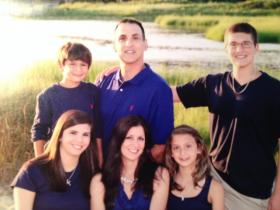 Beloved coach Peter Gonnella of Harwich, shown here with his wife, Kerry, and their four children, died of pancreatic cancer at the age of 48.