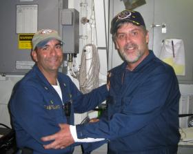 Captain Phillips (right) with Commander Frank Castellano of the USS Bainbridge after being rescued.