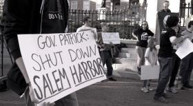 Protestor urging Massachusetts Gov. Patrick Deval to shut the Salem Plant.