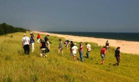 Citizen scientists documenting invasive plant species on Nantucket.