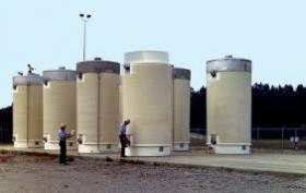 Some residents near the Pilgrim Nuclear Power Station are concerned about their property values as spent fuel from the reactor is moved to long-term, dry-cask storage units like these.