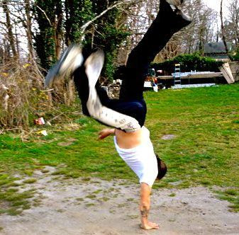 Leandro Lemos practicing Capoeira moves at his home in Vineyard Haven.