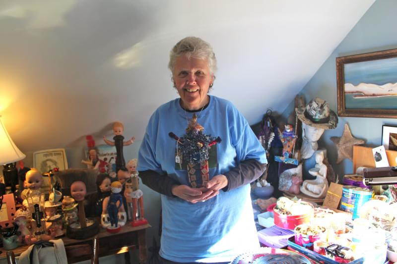 Susan Wasson in her studio with her Meme Spirit doll.