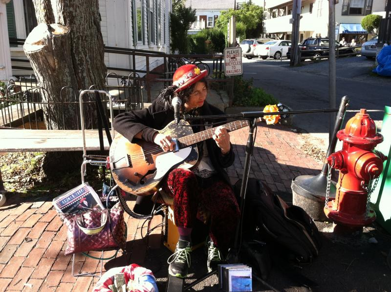 Marcia Mello busking on Commercial Street in Provincetown