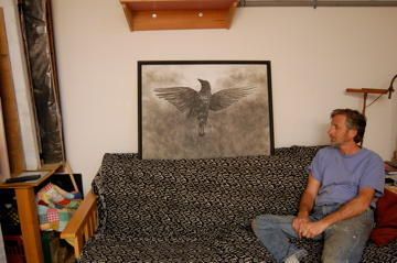 King in his studio with his crow painting, painted with crow ashes.