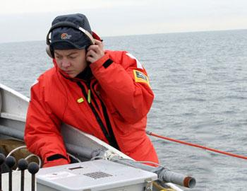 Sophie-Marie Van Parijs of the Northeast Fishery Science Center listens in on underwater sounds.