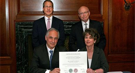 Leaders from the University of Chicago and the Marine Biological Laboratory met in New York City on Monday to sign an agreement to form an affiliation between the institutions. Clockwise from top left: University of Chicago Board of Trustees Chairman Andr