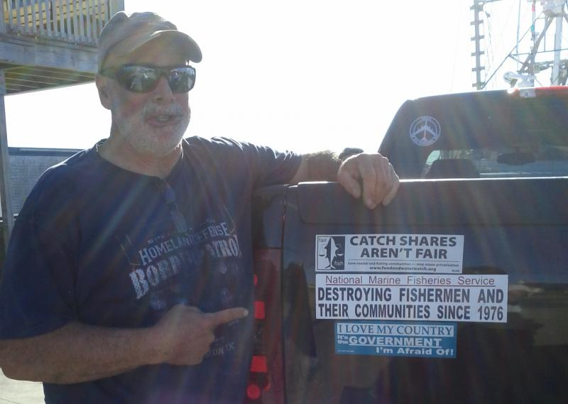 Rhode Island fisherman Joel Hovanesian points to the bumper sticker he says he created.