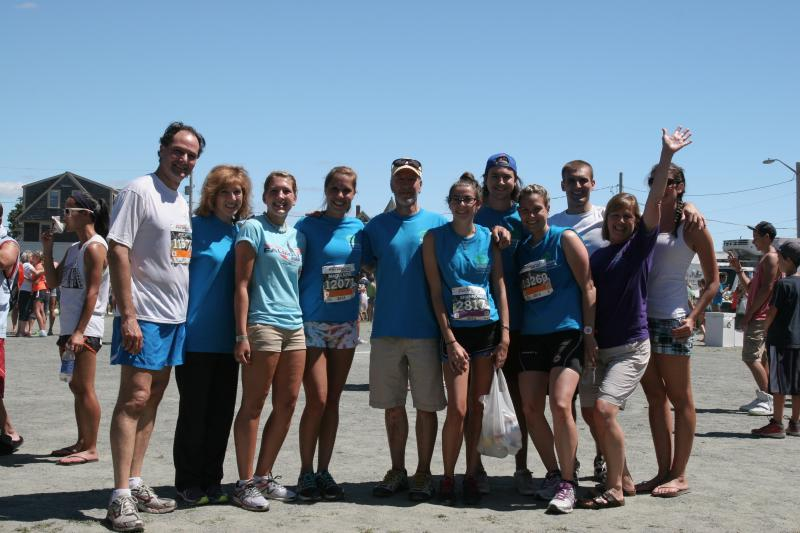 Dr. Jeremy Schmahmann and his wife (at left) with the Kulis family at the 41st Annual Falmouth Road Race.