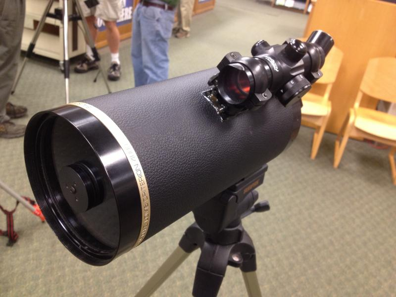 Modified telescope, with a gun site scope added to the top.