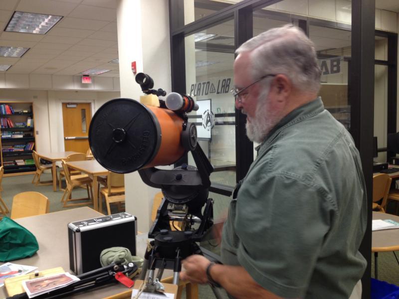 Peter Kurtz shows off his orange Celestron Telescope