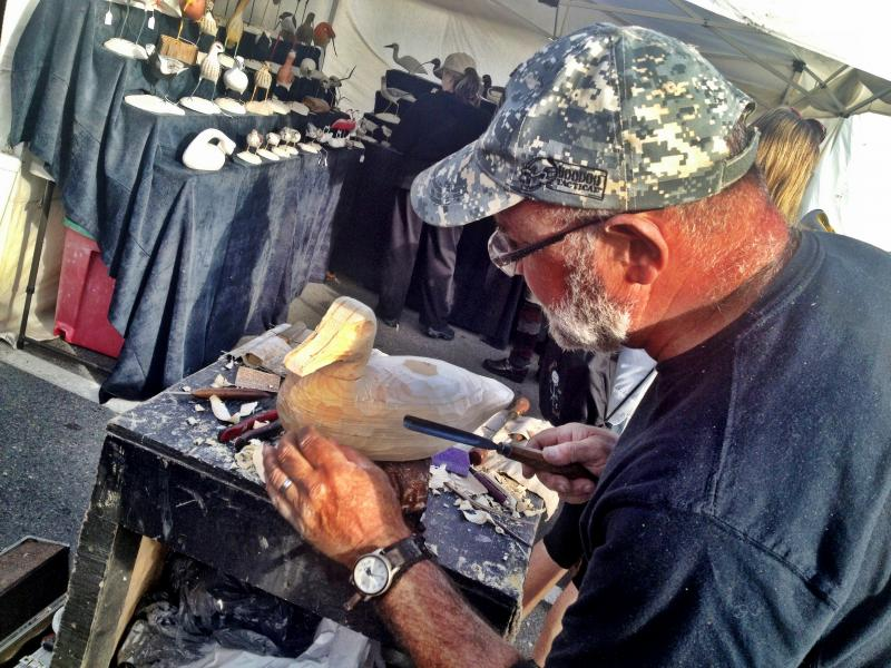 Artisans lined the street including this bird carver.