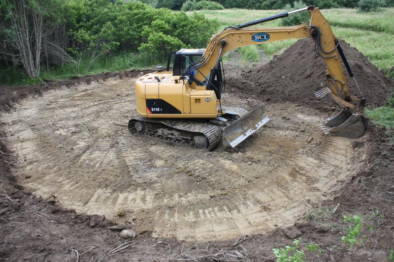 "Heavy machinery helps create a new ""vernal pool"""